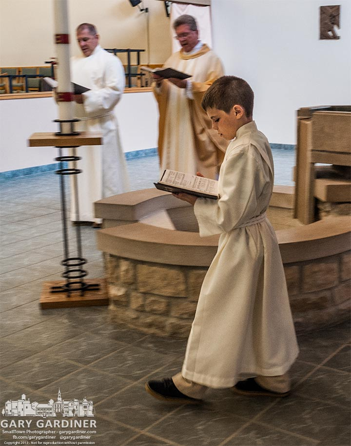 Grandson Owen Wheeler Ryan Stansifer performs altar boy duties at St. Elizabeths