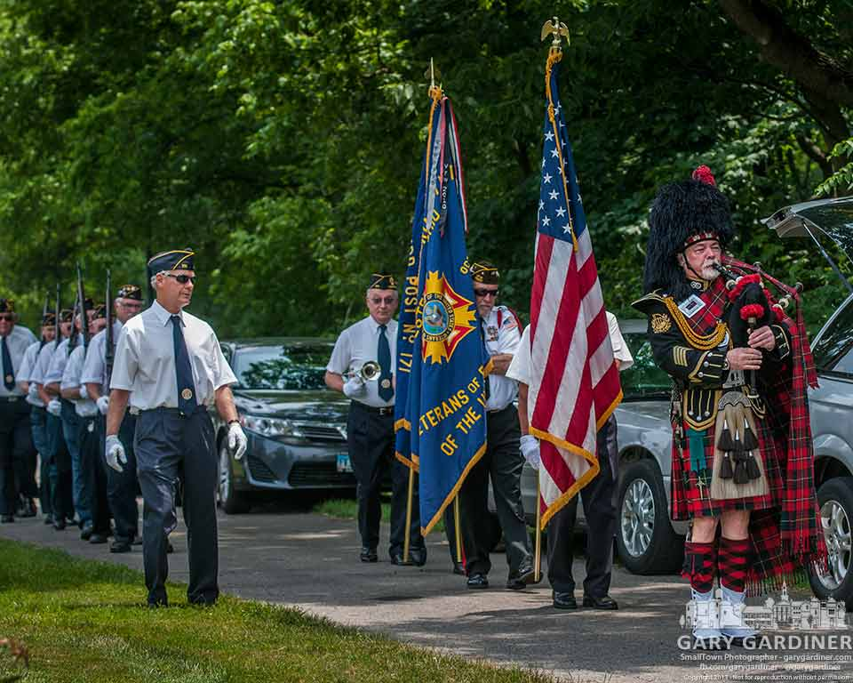 A bagpiper leads a military honor guard at a soldier's funeral at Otterbein Cemetery. My Final Photo for June 22, 2013.