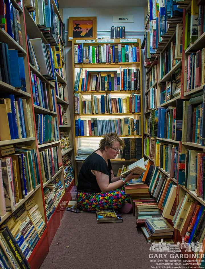 Teri searching through Book Harbor shelves during its closeout sale is My Final Photo for June 16, 2013