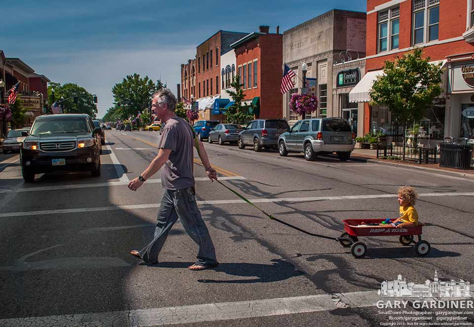 Youngster gets a red wagon ride from Grandpa through Uptown Westerville. My Final Photo for June 15, 2013