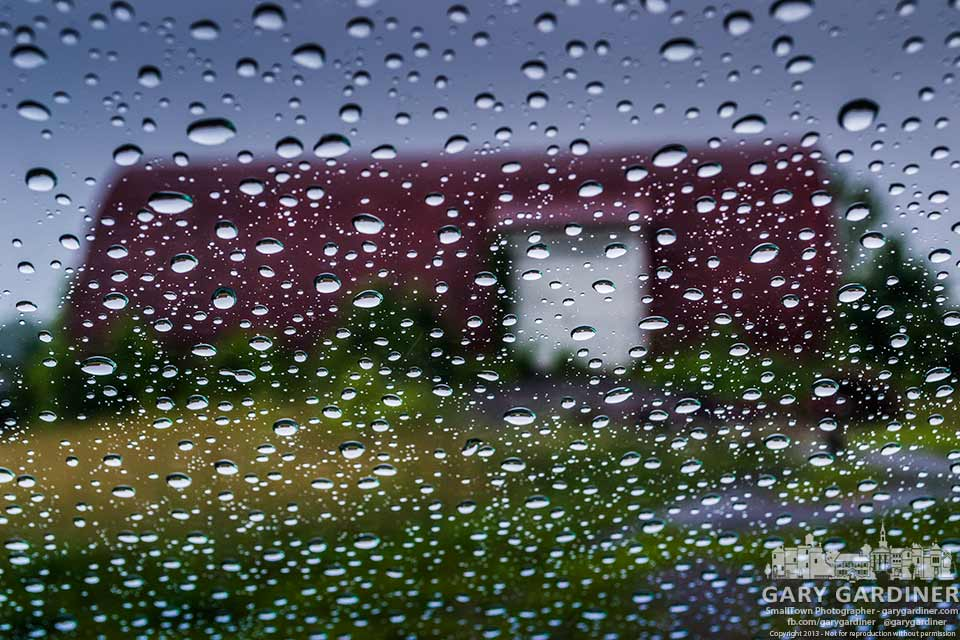 Raindrops cover my windshield as I wait for a break in the rain to photograph the farm on Cooper Road. My Final Photo for July 9, 2013.
