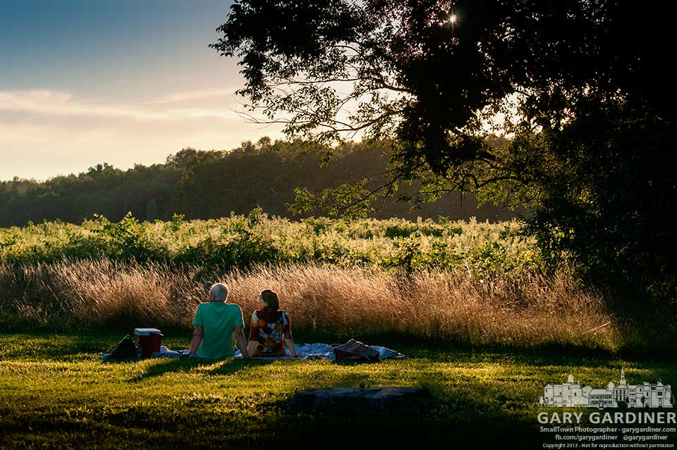 A couple finishes their picnic at sunset along the edge of the prairie at Sharon Woods Park. My Final Photo for July 26, 2013.