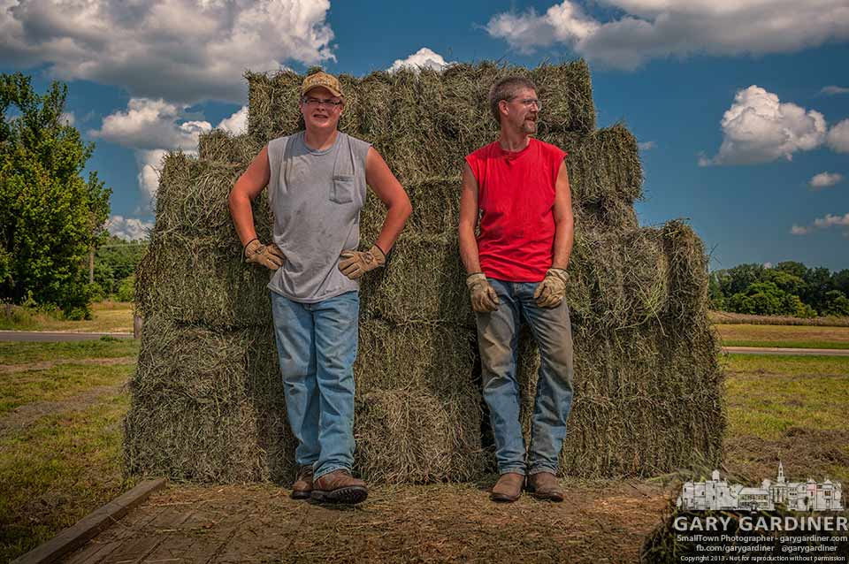 Two farm workers ready themselves to finish loading a trailer with hay cut on the Cooper Road farm. My Final Photo for July 15, 2013.