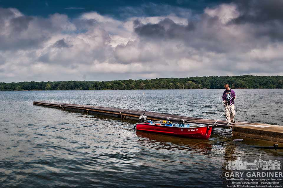 A young man readies his boat for launch at Hoover Reservoir after the weather cleared. My Final Photo for July 27, 2013.