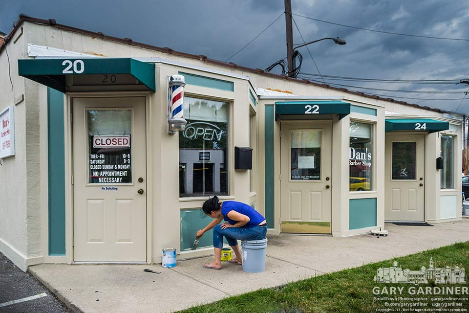 Painters apply new colors to Dan's Barber shop along Hatwood Alley for My Final Photo for July 1, 2013