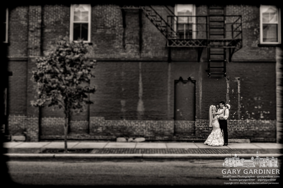 Newly married couple poses for wedding photos at State and College. My Final Photo for July 20, 2013.