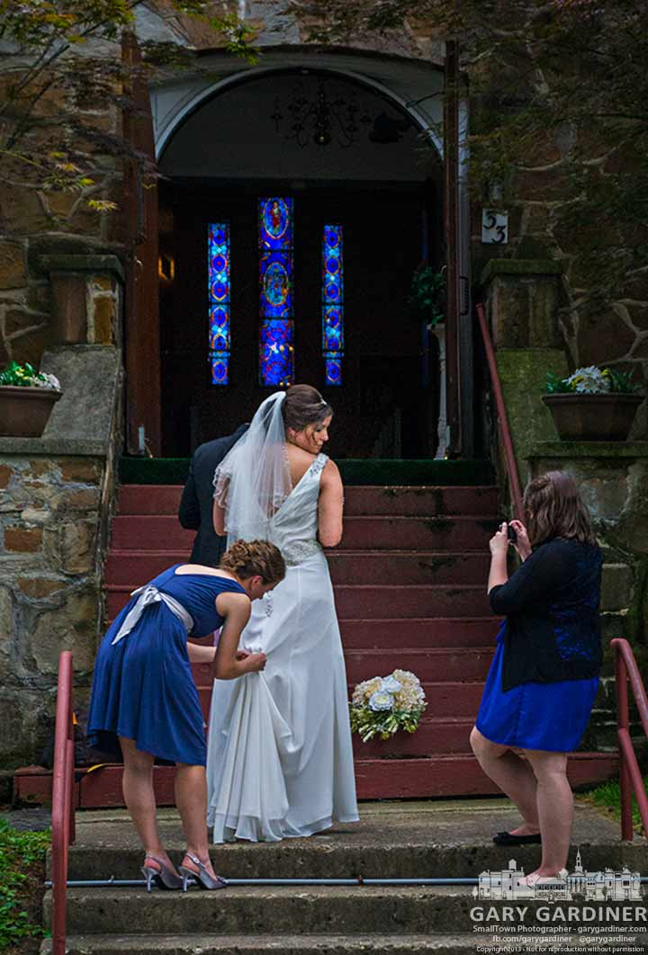 The Maid of Honor prepares the bride for the wedding reception following ceremonies at Columbus Family Worship Assembly Church