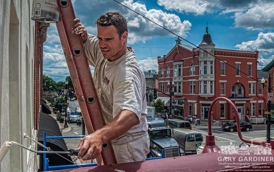 Painter touches up the facade of Amish Originals Furniture Company in Uptown Westerville. My Final Photo for Aug. 14, 2013.
