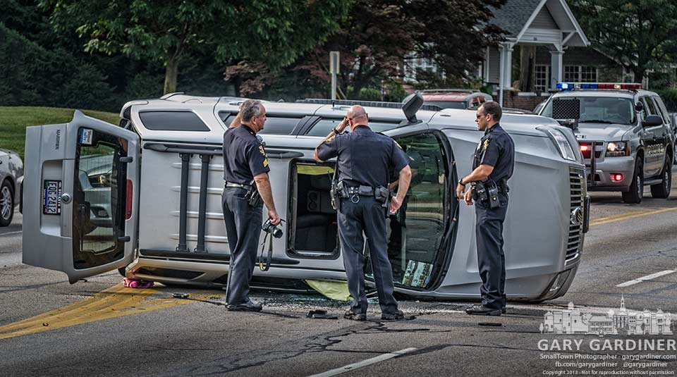 Westerville police investigate the scene of an accident in front of the old national Guard armory on South State Street. My Final Photo for Aug.28, 2013.