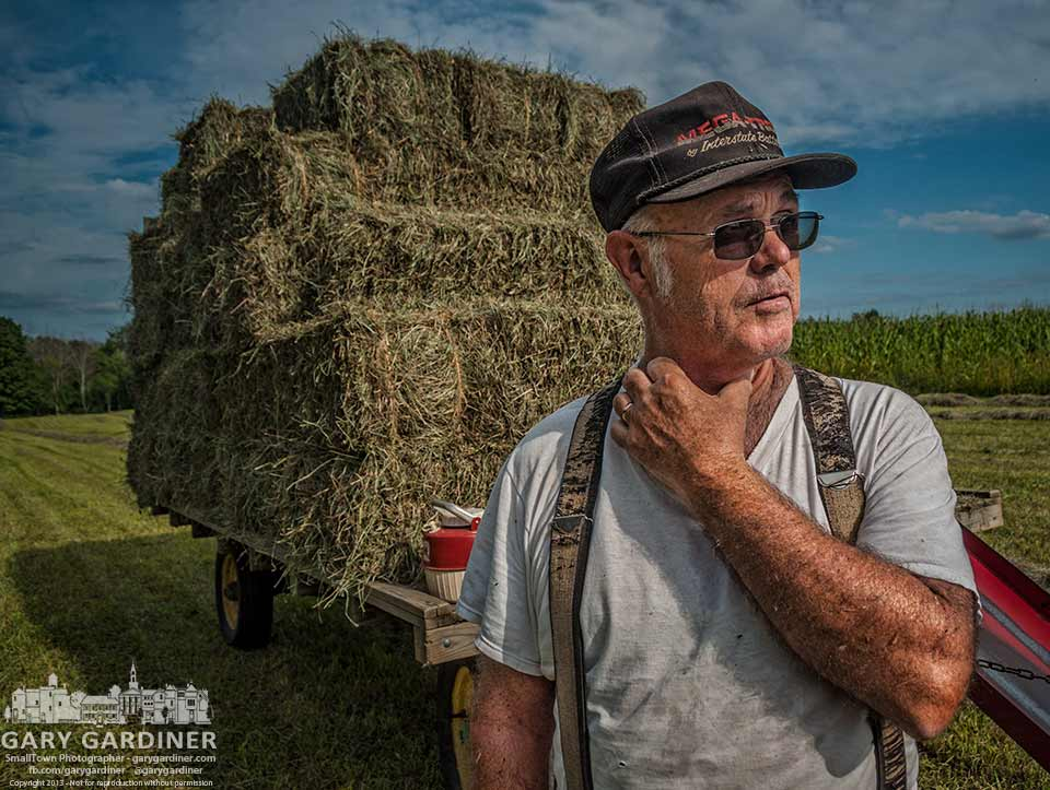 Farmer Sam Bigham takes a break in loading hay on his Westerville farm. My Final Photo for Aug. 16, 2013.