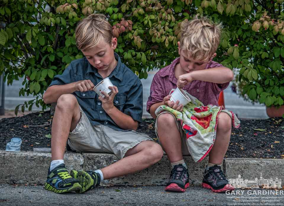 Two youngsters dig deep into the cups of ice cream they bought at the Uptown Westerville Farmers Market. My Final Photo for Aug. 21, 2013.