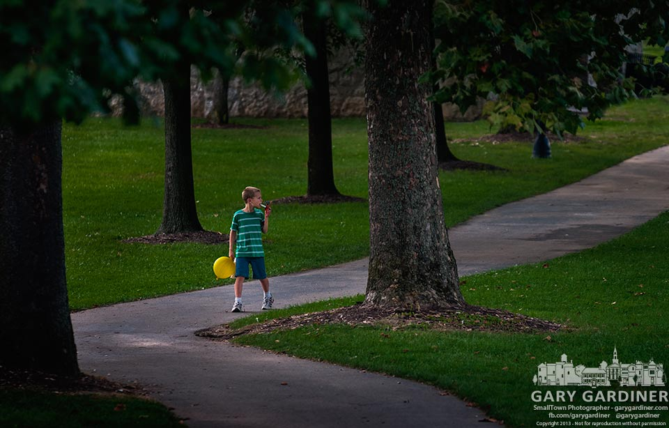 A young boy carries his bright yellow balloon through Alum Creek Park on the way to a performance by puppeteers in the amphitheatre. My Final Photo for Aug. 7, 2013
