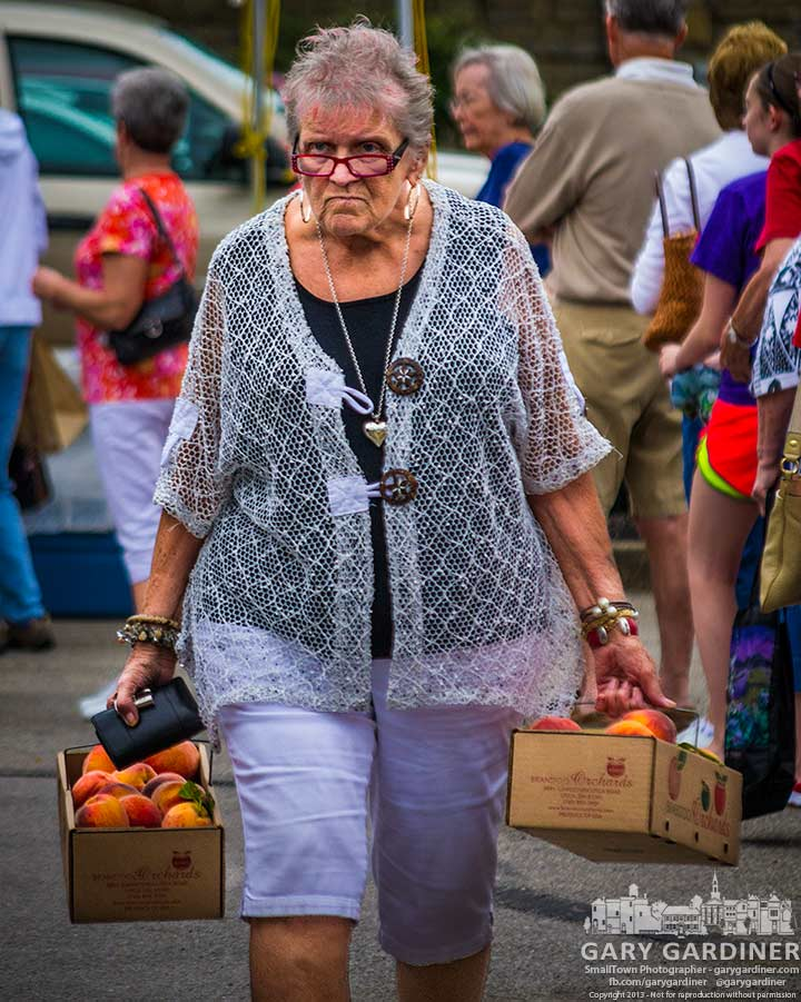 Market shopper heads home after standing in a line of more than 100 people for peaches. My Final Photo for July 31, 2013.