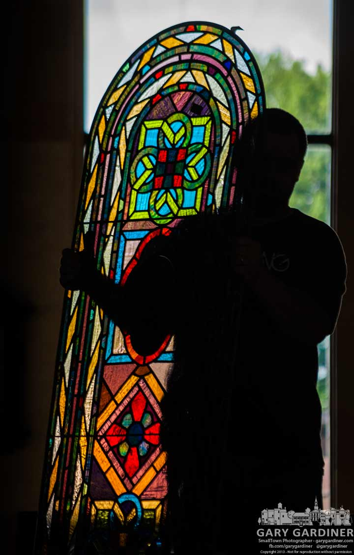 An installer carries one of the 23 new stained glass windows for the Cupola at St. Paul Catholic Church. My Final Photo for Aug. 1, 2013.
