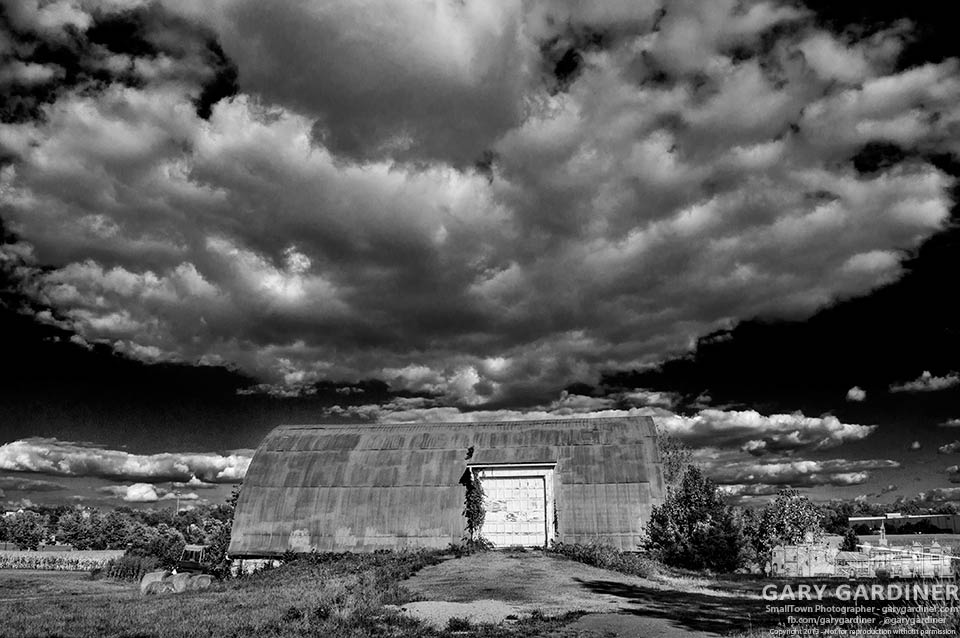 Late summer clouds move swiftly over fields and barn at the Cooper Road farm. My Final Photo for Sept. 16, 2013.