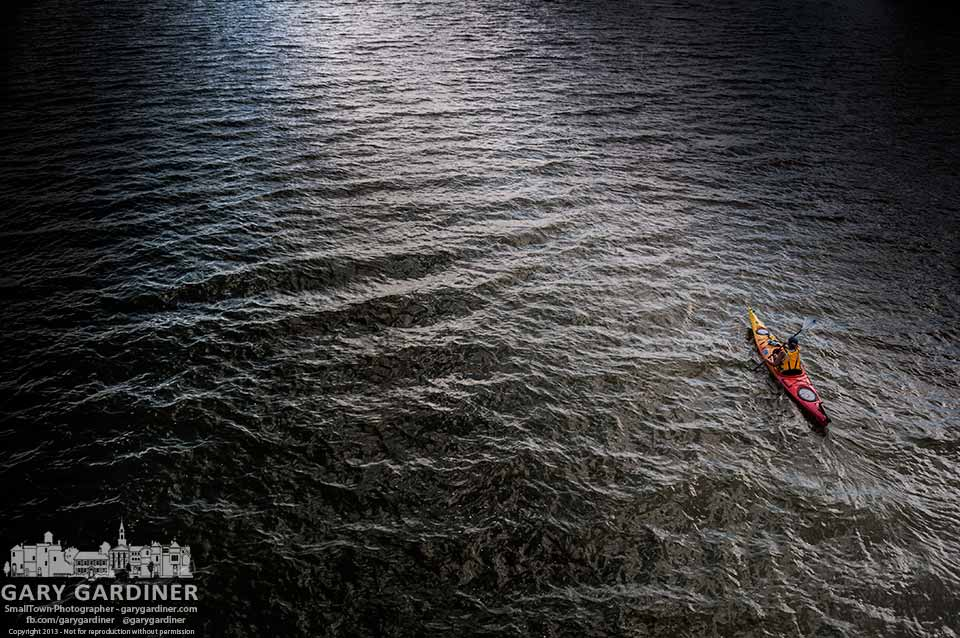 A kayaker glides across the rough surface of Hoover reservoir as the sun sets on a Sunday. My Final Photo for Sept. 1, 2013.