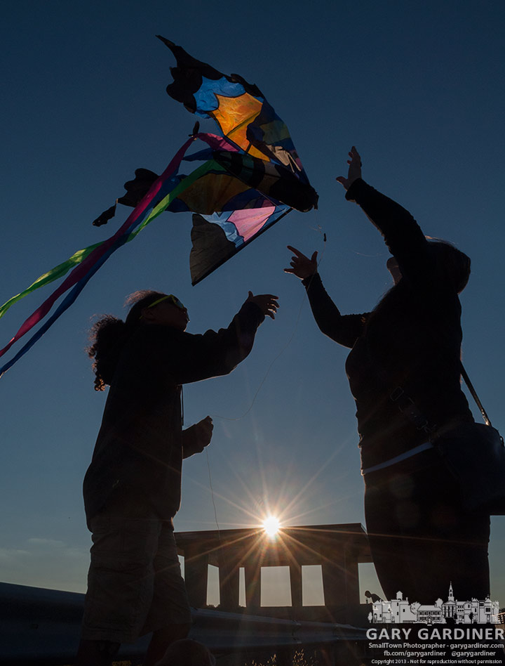 A mother and her two children struggle to launch their kite into the  wind blowing across Hoover Reservoir Dam. My Final Photo for Sept. 22, 2013.