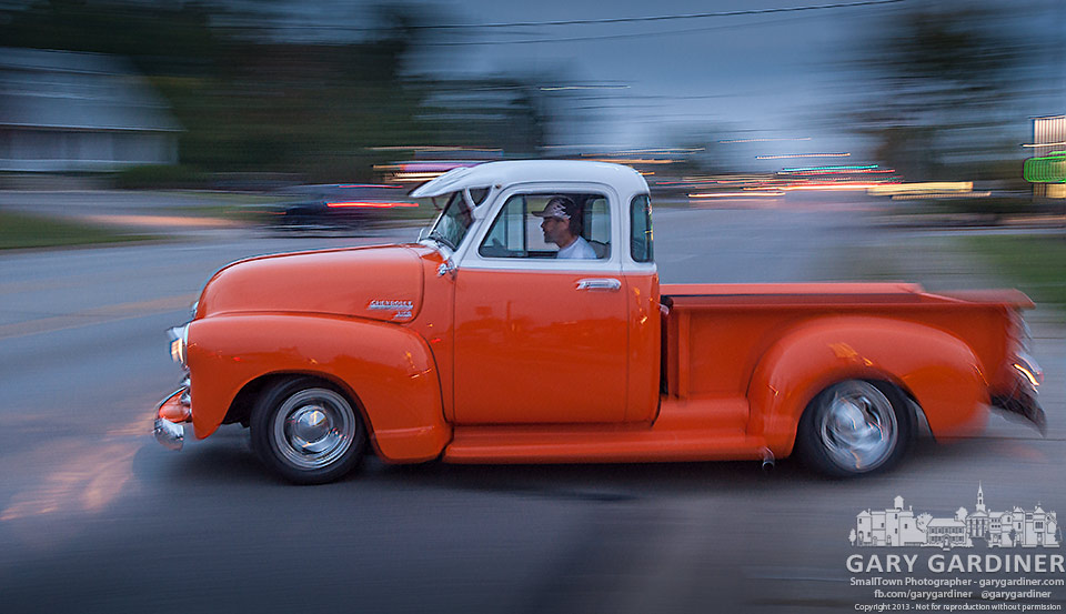 One of the hot rods at Yogi's Hoagies regular Friday night hangouts turns onto State Street as he leaves before the arrival of a rain storm. My Final Photo for Sept. 20, 2013.