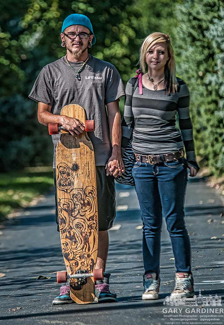 Couple on way to McDonalds on their long board pause for photo.y Final Photo for Sept. 5, 2013.
