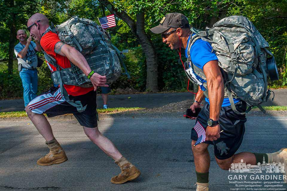 Two runners in the @TravisManionFoundation 9/11 Heroes Run sprint to the finish wearing full packs. My Final Photo for Sept,. 7, 2013.