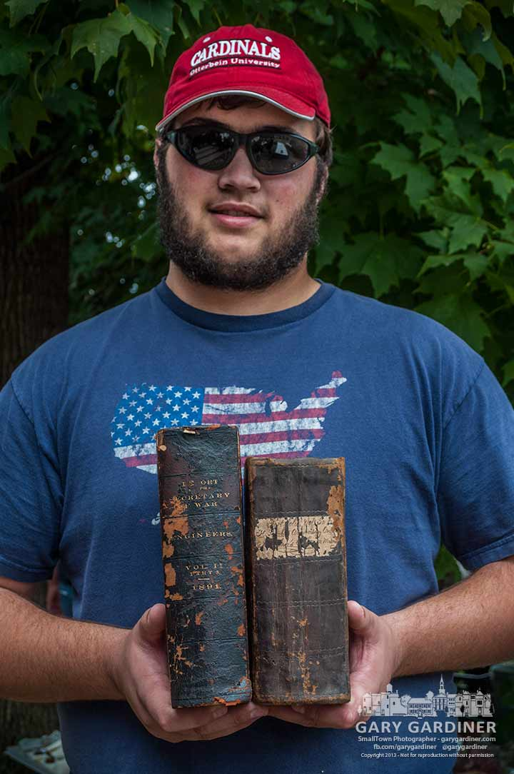 Otterbein University student Chris crum holds the two rare books he bought at the final auction from Book Harbor in Uptown Westerville. My Final Photo for Oct. 13, 2013.