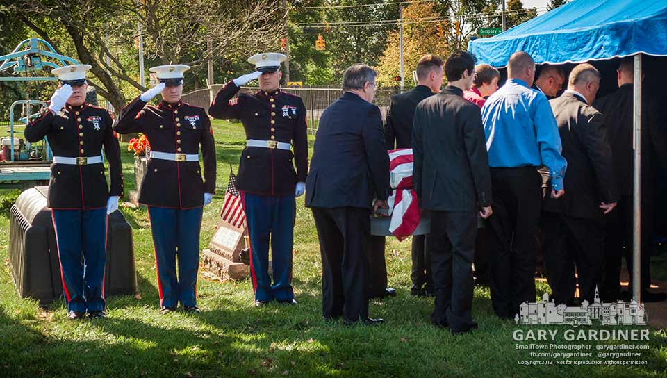 "Three active duty Marines salute the flag-draped casket of Robert ""Bob"" Takacs as pall bearers carry it for his internment at Blendon Central Cemetery. My Final Photo for Oct. 11, 2013."