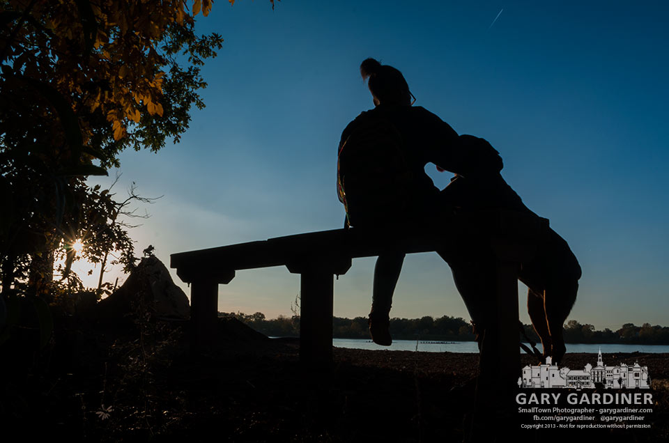 A young girl and her dog sit on a bench on the shore of Hoover Reservoir enjoying the warmth of the sun on an autumn day. My Final Photo for Oct. 14, 2013.