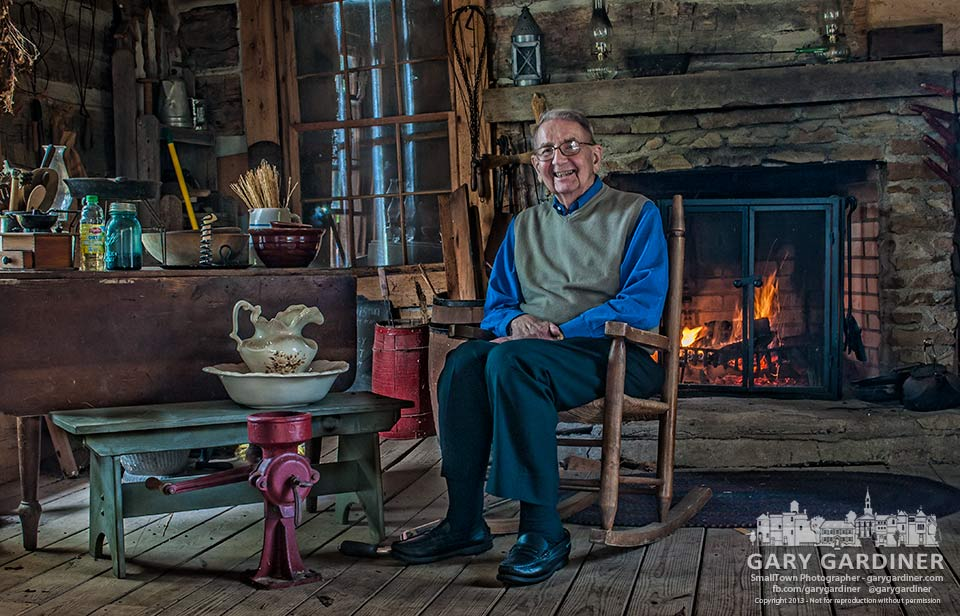 Retired Dr. Paul Metzger sits in a rocking chair in the log cabin that once was his family's home on the Metzger farm in the early days of Westerville. My Final Photo for Oct. 6, 2013.