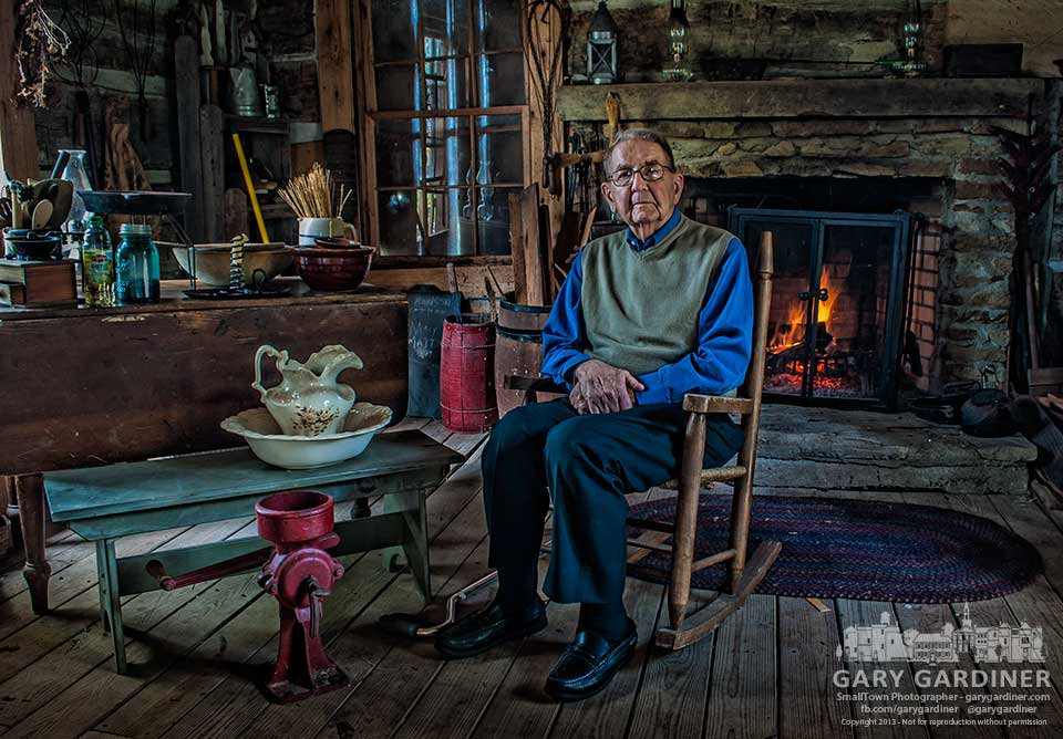 Retired Dr. Paul Metzger sits in a rocking chair in the log cabin that once was his family's home on the Metzger farm in the early days of Westerville,. My Final Photo for Oct. 6, 2013.