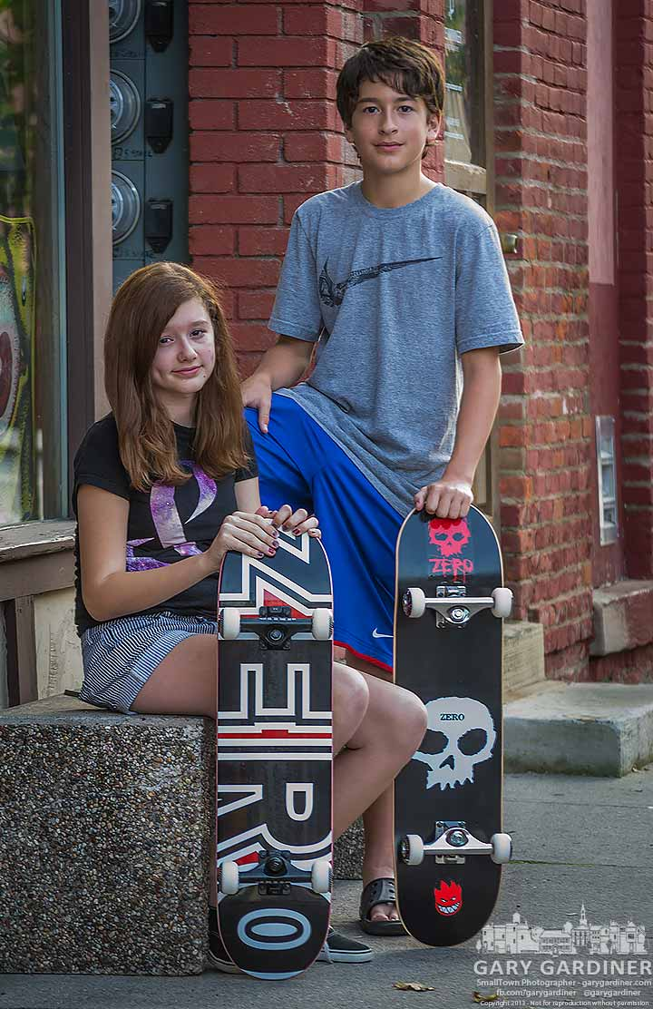Brother and sister pose with their new skateboards, bought together at OldSkool. My Final Photo for Oct. 2, 2013.