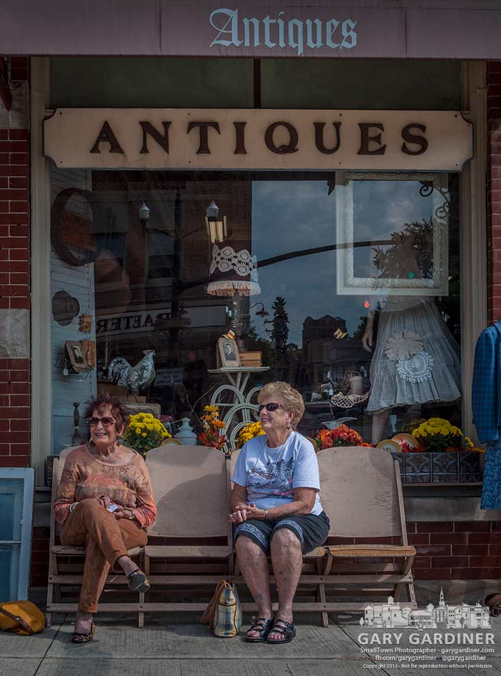 Two women take a break from shopping in the row of chairs outside Westerville Antiques in Uptown. My Final Photo for Oct. 4, 2013.