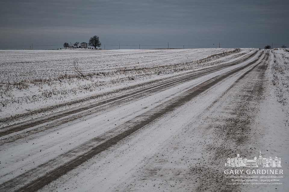 Snow-covered farm fields and a gravel country road on Thanksgiving Day. My Final Photo for Nov. 28, 2013.