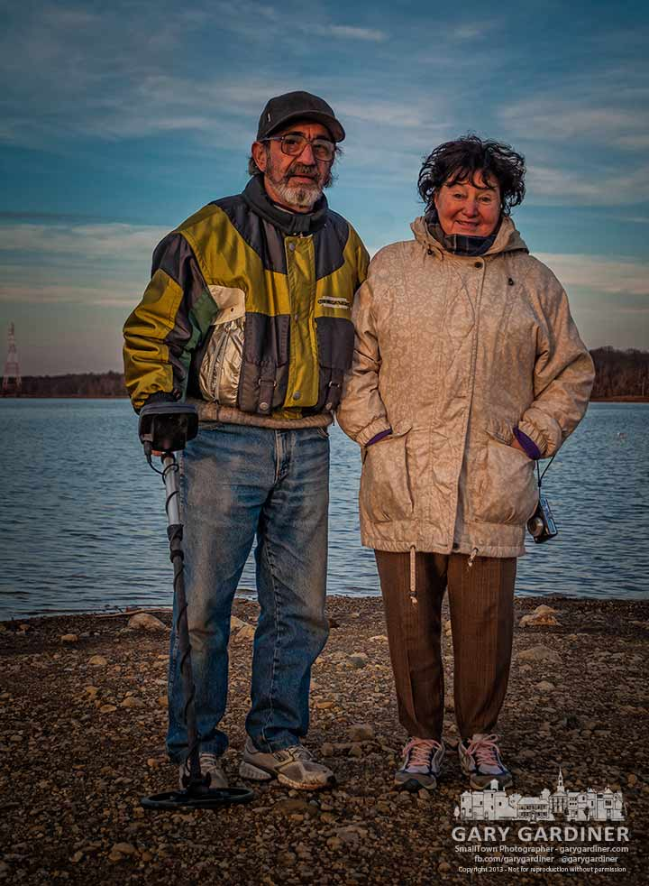 A couple testing a metal detector pause for a photo at the end of their search at Hoover Reservoir. My Final Photo for Nov. 19, 2013.