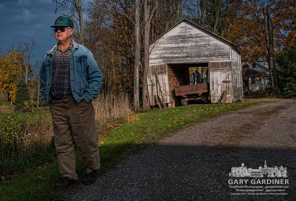 Sam Bigham walks into the shadow of the barn on his farm where he sees his last harvest as owner. My Final Photo for Nov. 2, 2013.
