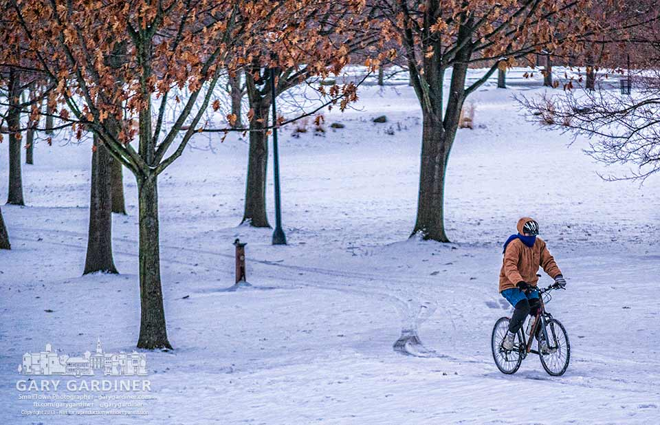 A bicyclist navigates her way along the ice and snow covered walkways through Alum Creek Park.  My Final Photo for Dec. 18, 2013.