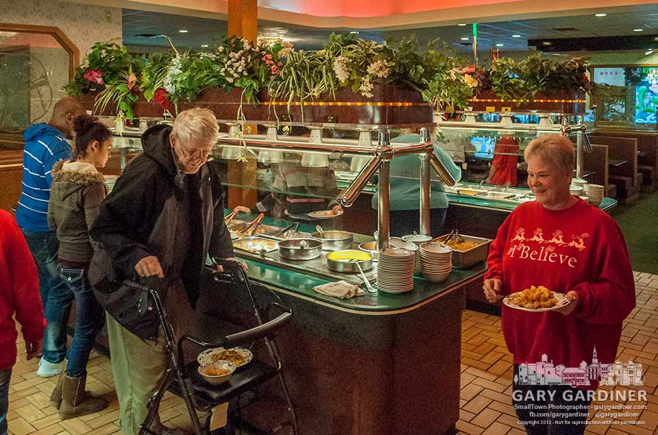 Families and friends make their Christmas Day meal selections from the buffet at the China Garden restaurant in Westerville. My Final Photo for Dec. 25, 2013.