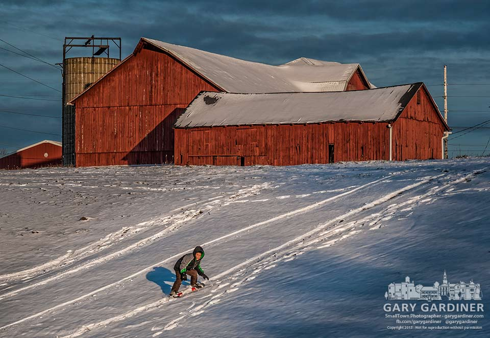 Seven-year-old Giovanni rides his snowboard down the slope behind the barns on the Yarnell Farm on Africa Road. My Final Photo for Dec. 12, 2013.