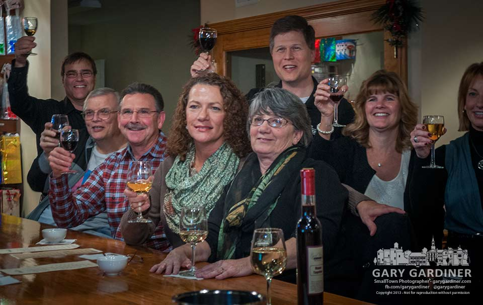 Customers toast themselves as they pose for a group photo at Good vibes Winery in Uptown Westerville marking the 80th anniversary of the repeal of prohibition. My Final Photo for De. 5, 2013.