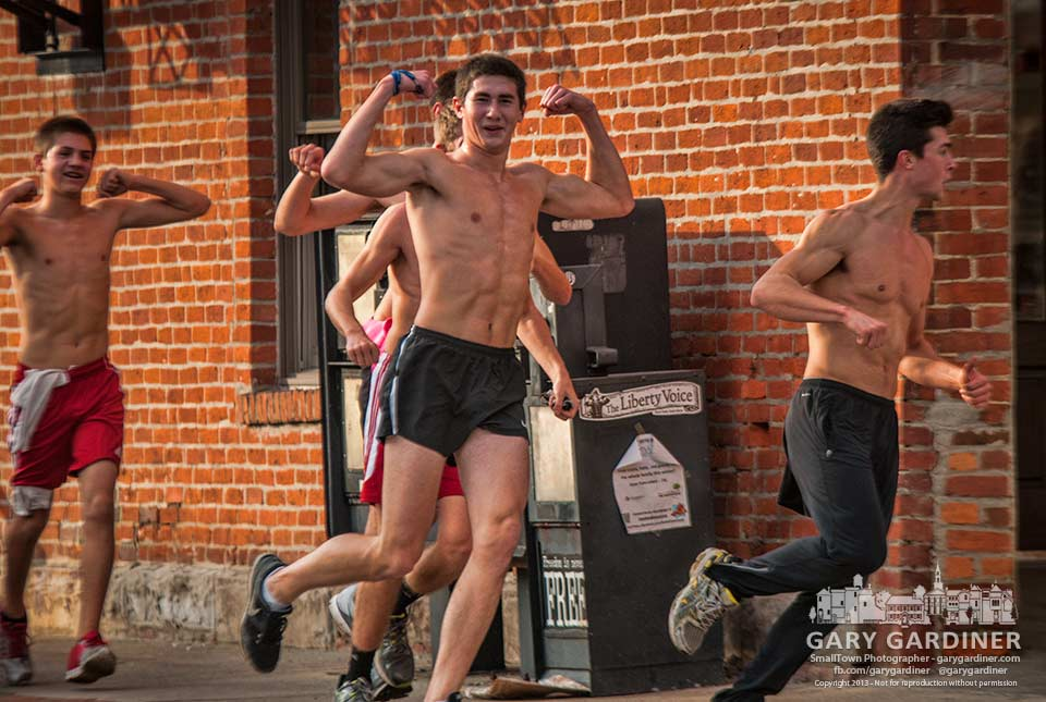 A columns of shirtless runners rounds State and College in Uptown offering a display of their physical prowess on what may prove to have been the warmest day of the month. My Final Photo for Dec. 4, 2013.