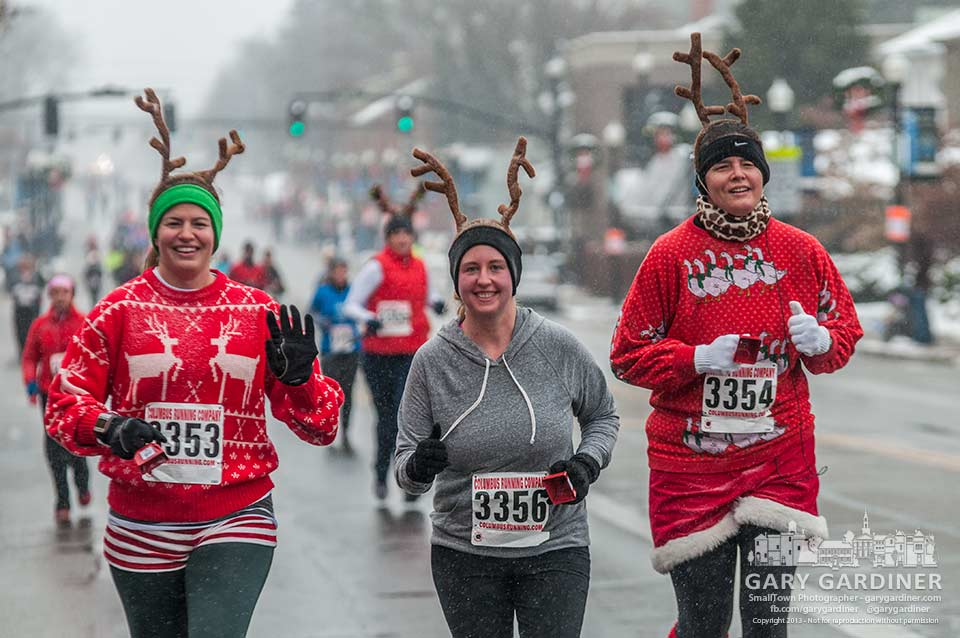 Three athletes in the Rudolph Run leading the Westerville Christmas parade approach Uptown on the final leg of the wet, cold, brisk fun competition. My Final Photo for Dec. 8, 2013.