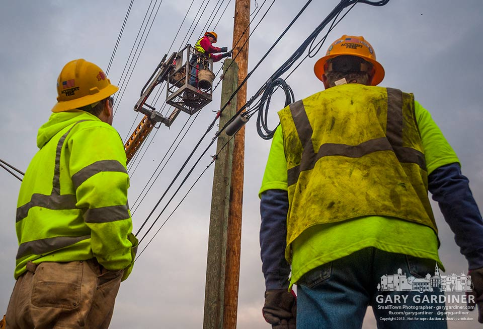Utility workers move a fiber optic cable to a new pole along Cleveland Avenue as part of the upgrade for expected construction. My Final Photo for Dec. 2, 2013.