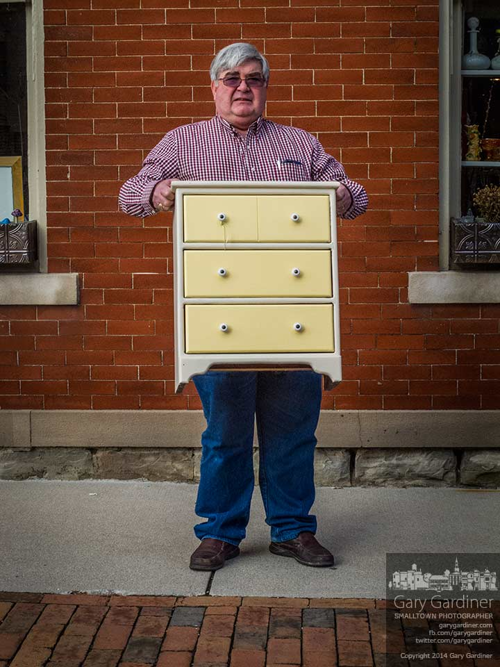Bill Davis pauses to display the chest of drawers his wife bought at Westerville Antiques. My Final Photo for Jan. 12, 2014.