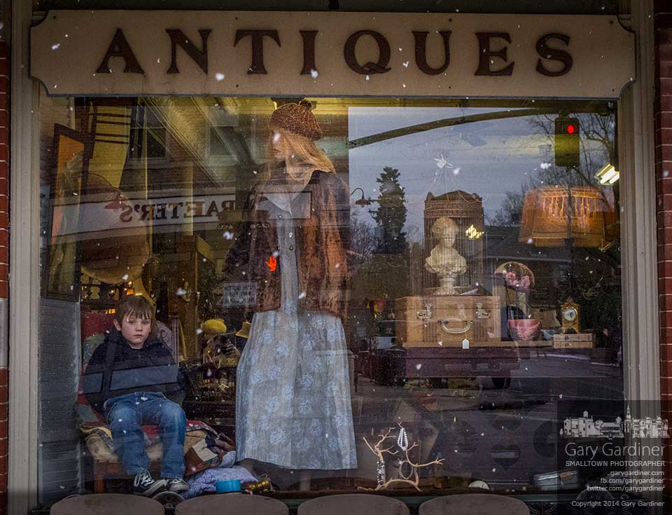 Five-year-old Hayden enjoys an afternoon with his grandfather by pretending to be a mannequin in the window at Westerville Antiques and surprise passersby with a sudden smile or by moving his eyes as they walk by. My Final Photo for Jan 9, 2014.