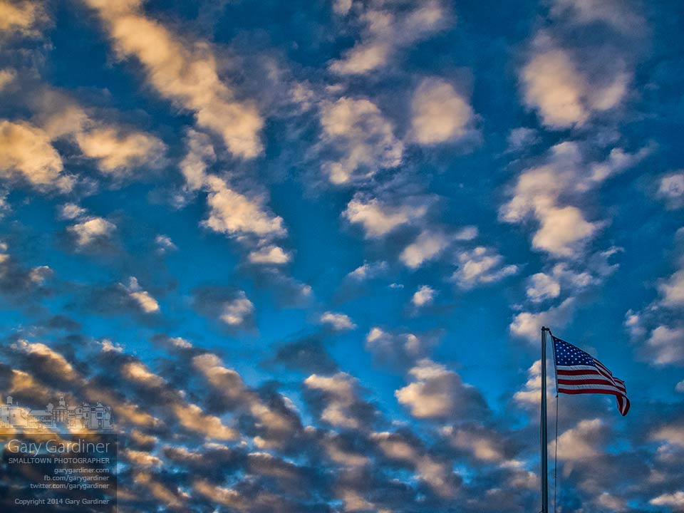 An American flag  flies in a cloudy sunset breeze that precedes a cold front expected to bring rain, snow, and colder temperatures. My Final Photo for Jan. 14, 2014.