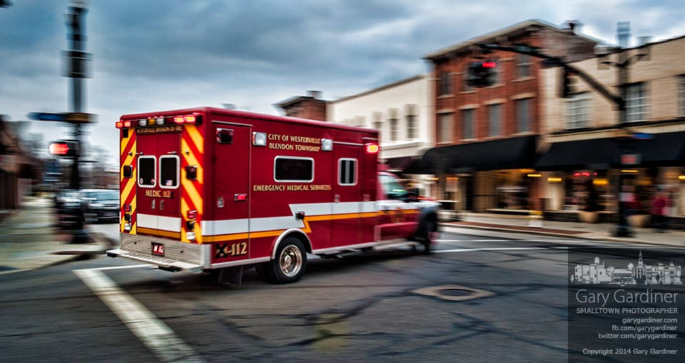 A Westerville fire department medic truck makes a hurried turn onto State Street during the late afternoon commute rush. My Final Photo for Jan. 15, 2014