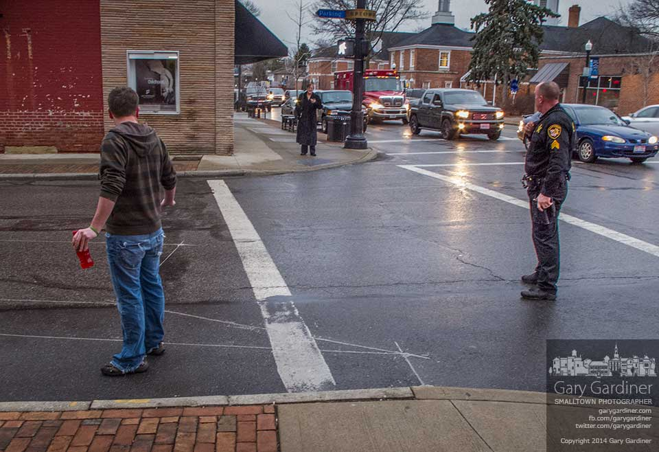 A sheriff's deputy listens as he begins to resolve a dispute between a man and woman at the corner of State and College in Uptown Westerville. My Final Photo for Jan. 13, 2014.