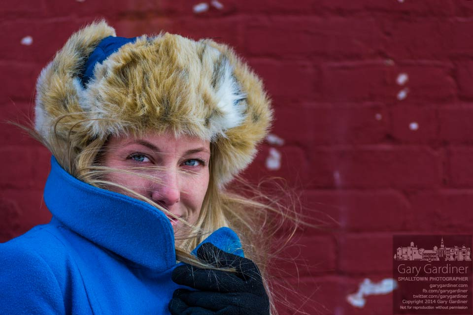 A fur hat, a warm coat, and an engaging smile help warm the day as temperatures dropped to near zero and strong winds deepened the cold in Uptown. My Final Photo for Jan. 24, 2014.