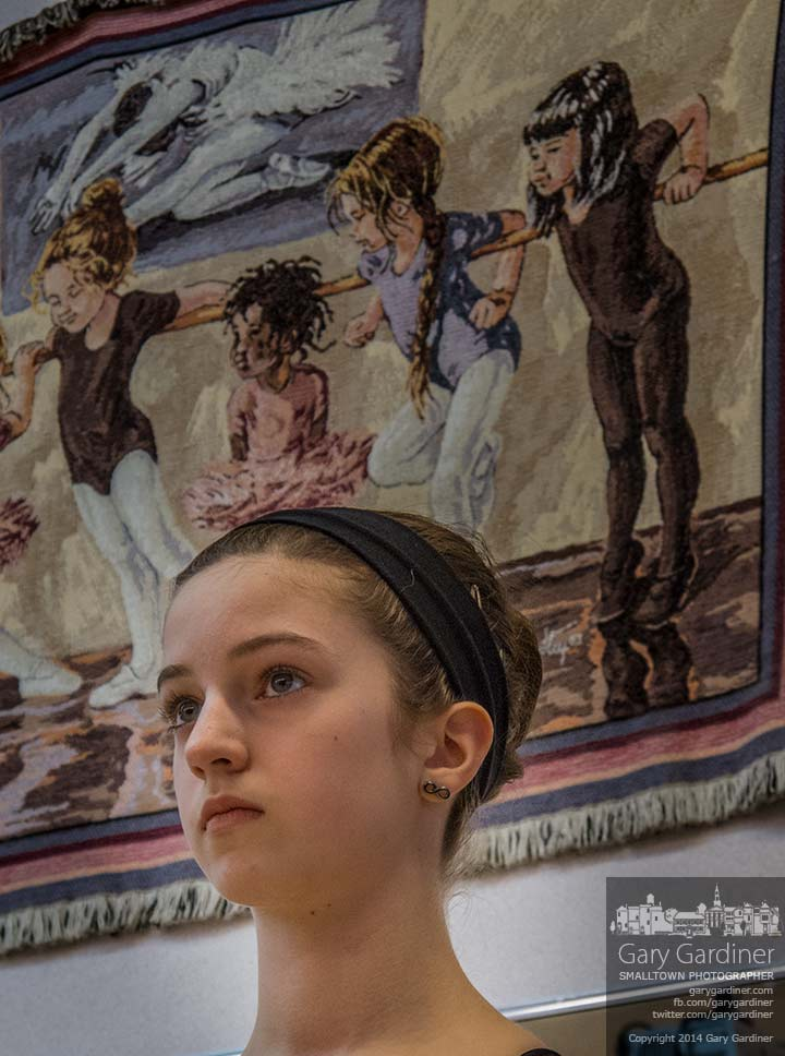A dancer standing beneath a small tapestry of younger dancers listens to instructions during a late afternoon class at Generations. My Final Photo for Feb. 19, 2014.