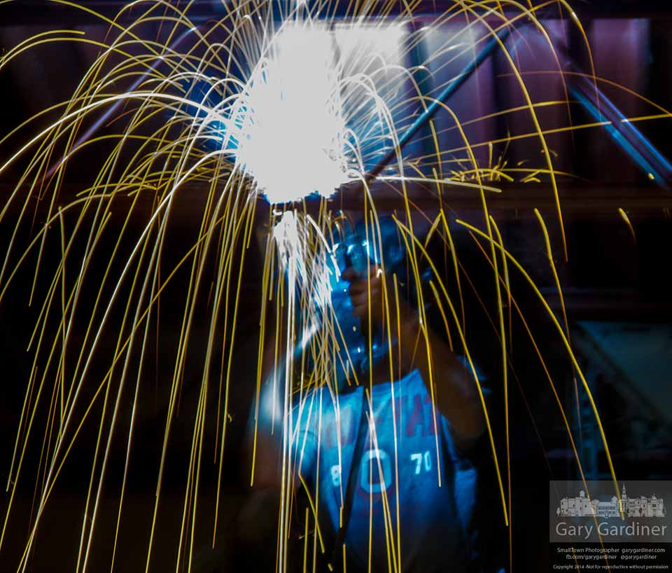 A welder fastens overhead struts to the ceiling over the front windows inside the Uptown Deli in Westerville. My Final Photo for Feb. 4, 2014.