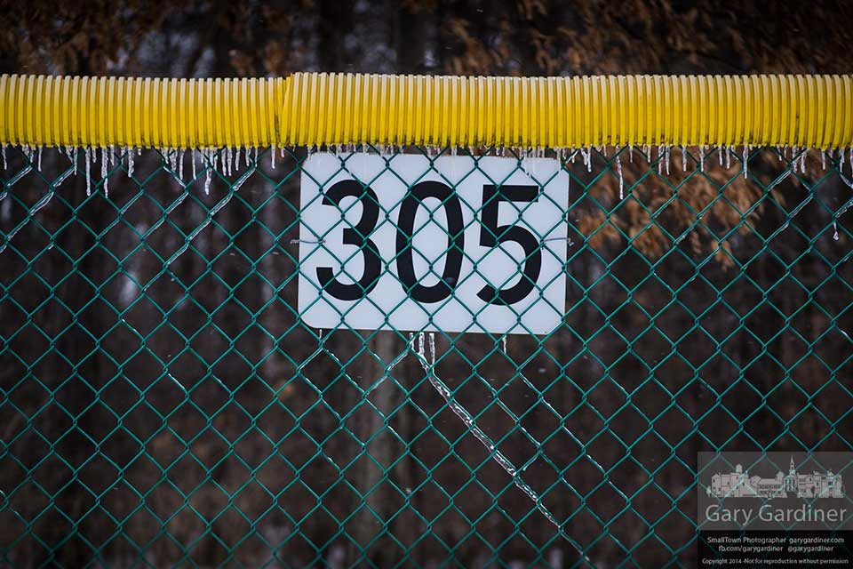 Icicles hang from the outfield fence on the softball fields at Hoff park. My Final Photo for Feb. 6, 2014.